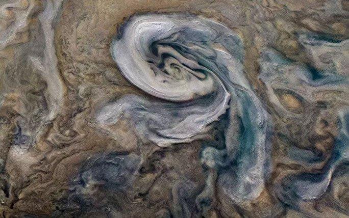 Bề mặt đẹp như tranh vẽ của sao Mộc hiển thị rõ những đám mây amoniac màu trắng