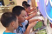 Trẻ em thành phố dùng điện thoại, máy tính bảng từ 30 phút đến 2 giờ mỗi ngày
