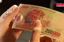 Xem số seri trên tờ tiền biết được tiền giả hay thật?