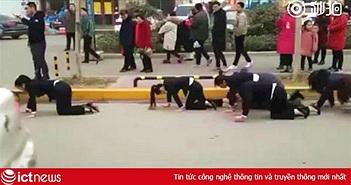 Trung Quốc: Dân mạng dậy sóng với đoạn video ép nhân viên bò ngoài đường