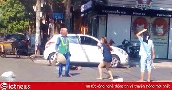 Nữ lao công bị đánh vì nhắc nhở cô gái vứt rác bừa bãi